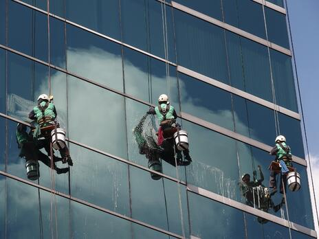 window washers harnessed outside tall building. What you need to know about fall protection.