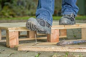 work boot stepping on nail
